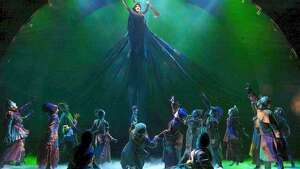 "**FILE**Idena Menzel as Elphaba, the wicked witch, ""flies"" with her broom over pursuers at the Gershwin Theatre in New York, in this undated publicity photo from the musical ""Wicked."" (AP Photo/Joan Marcus)"