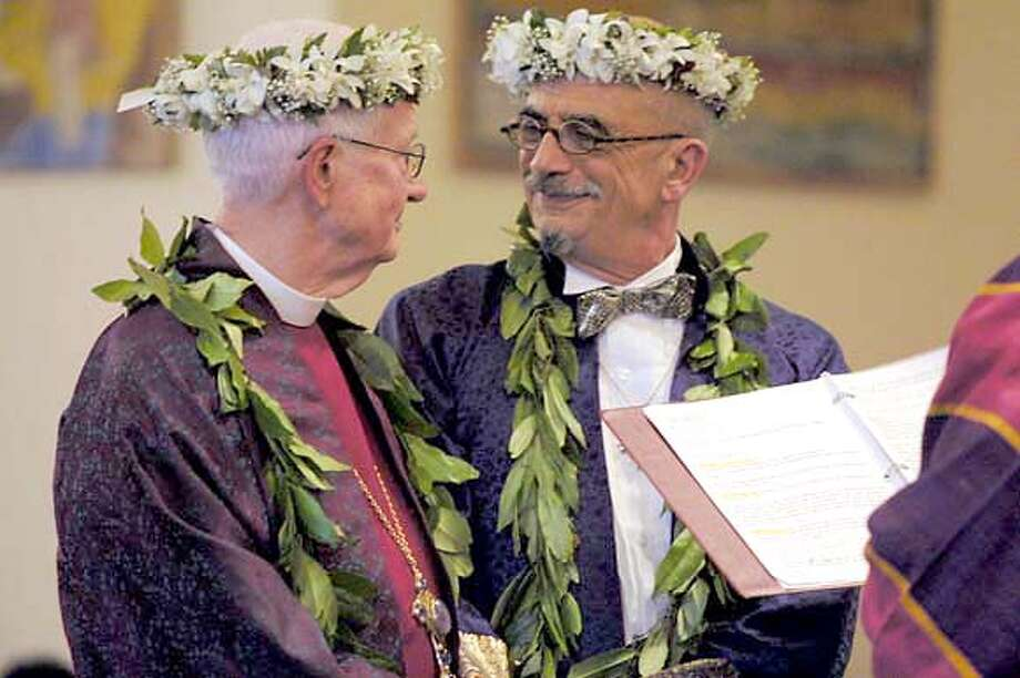 Otis Charles (left) marries partner Felipe Sanchez Paris before several hundred people at St. Gregory's of Nyssa Episcopal Church over the weekend of the 24th-25th of April Charles has become the world's first openly gay Christian bishop, and the first to wed his same-sex partner in church. Photo: Handout Photo