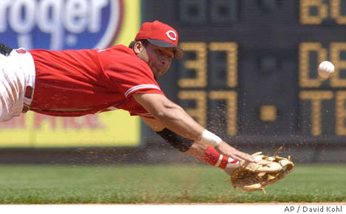 Cincinnati Reds' third baseman Juan Castro dives and misses a San Francisco Giants' Edgardo Alfonzo hit in the fourth inning, Sunday, May 9, 2004 in Cincinnati. (AP Photo/David Kohl)