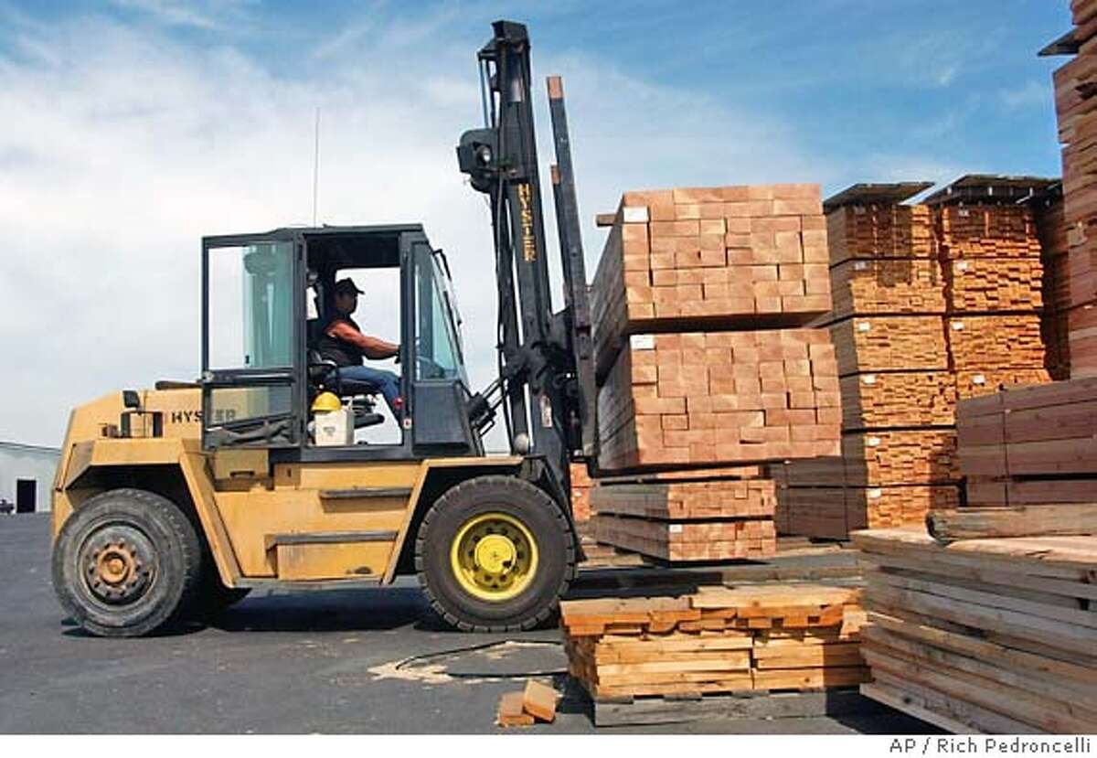 A forklift load of milled lumber is stacked at the Wetsel-Oviatt Lumber Co., in El Dorado Hills, Calif., Monday, Sept. 8, 2003. Cecil Wetsel says his Wetsel-Oviatt Lumber Co. can no longer compete against foreign timber in California's economic climate. So he's closing the third-generation business in mid-October and selling off its 17,600 acres of Sierra Nevada timberland. (AP Photo/RichPedroncelli) CAT