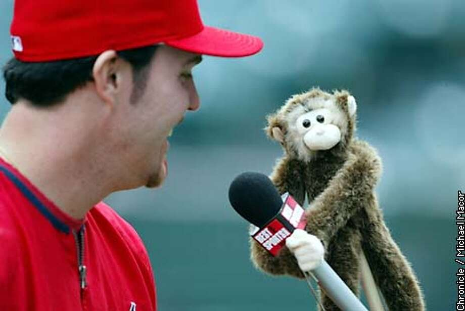 Anaheim Angels Scott Spiezio is interviewed the The Best Damn Sports Show Period monkey during team practice at Edison Field Thursday October 17, 2002. The San Francisco Giants play the Anaheim Angels in the World Series with game one and two being played in Anaheim. Michael Macor/San Francisco Chronicle Photo: Michael Macor