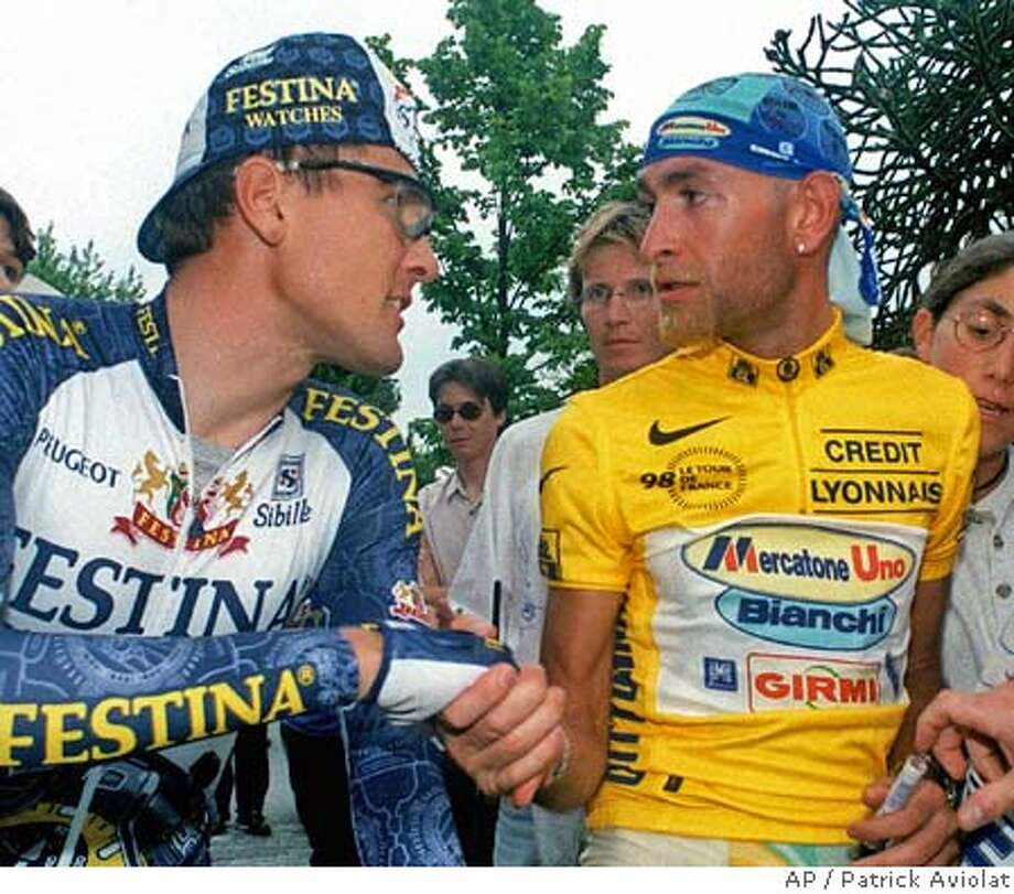 "Festina team cyclist Alex Zuelle, of Switzerland, left, shakes hands with Marco Pantani of Italy before the exhibition cycling race ""A travers Lausanne"", in Lausanne, Switzerland, Tuesday August 4, 1998. Swiss members of Festina team, Alex Zuelle, Laurent Dufaux and Armin Meier made their first public appearance after being banned from the Tour de France. (AP Photo/Patrick Aviolat) Photo: PATRICK AVIOLAT"