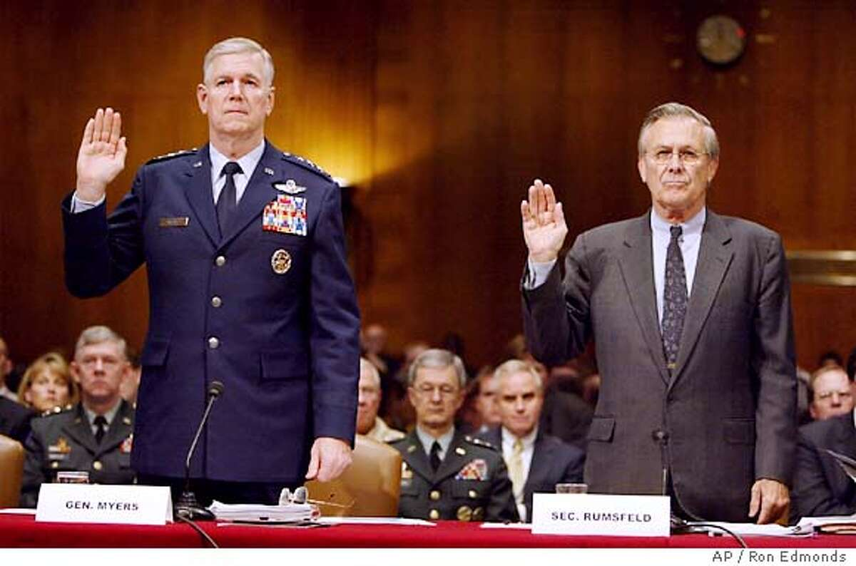 Defense Secretary Donald H. Rumsfeld, right, and Joint Chiefs Chairman Gen. Richard Myers are sworn in on Capitol Hill Friday, May 7, 2004, in Washington, prior to testifying before the Senate Armed Services Committee hearing on prisoner abuses in Iraq. (AP Photo/Ron Edmonds)