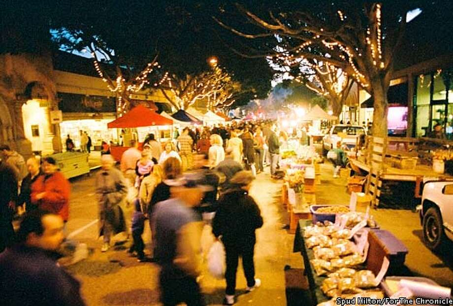 Moveable feast: The aroma of ribs and beef on the grill permeates the night air at San Luis Obispo's farmers' market, which attracts thousands to the Central Coast town. Photo by Spud Hilton, special to the Chronicle