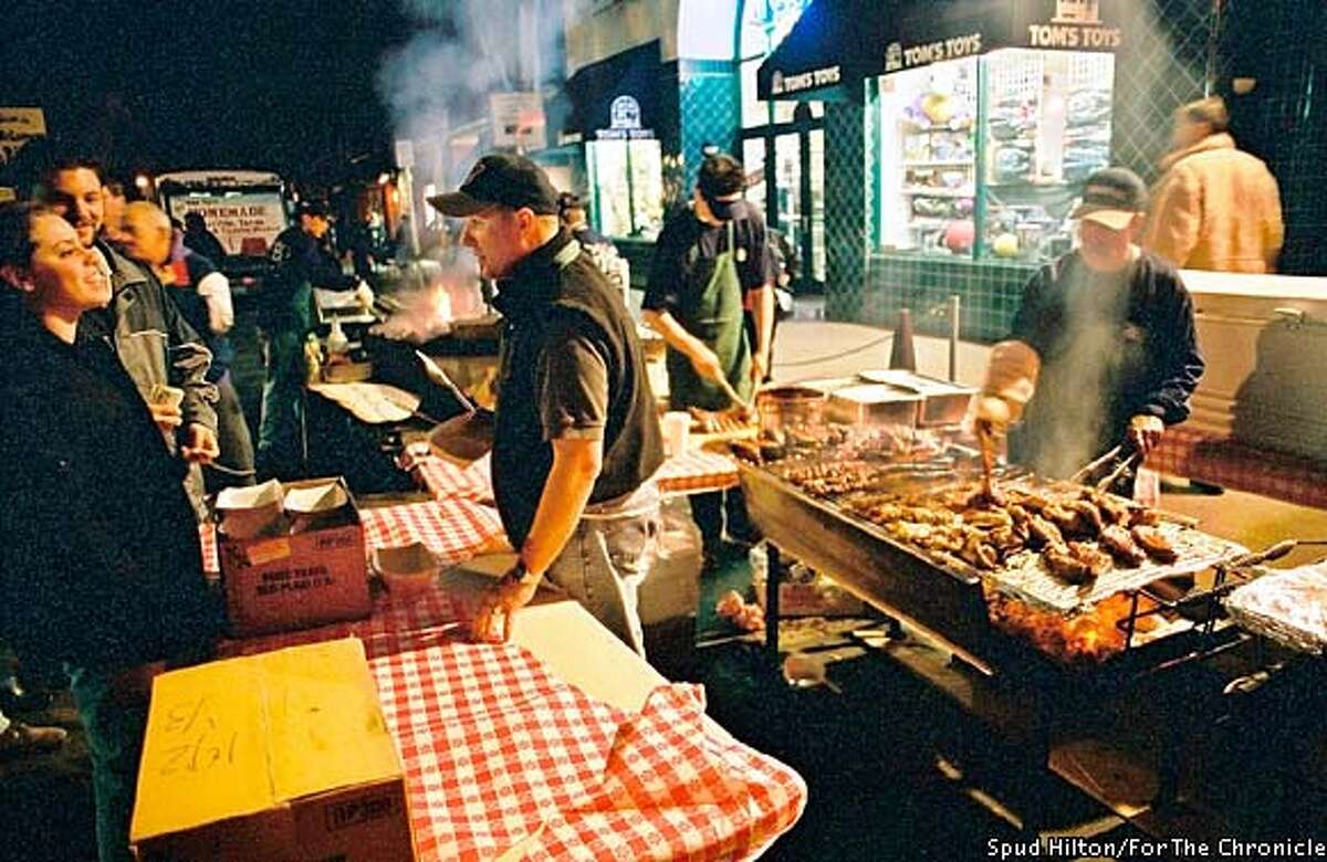 Rare treat: Only nine businesses are allowed to barbecue at the market, which can make for long lines. Photo by Spud Hilton, special to the Chronicle