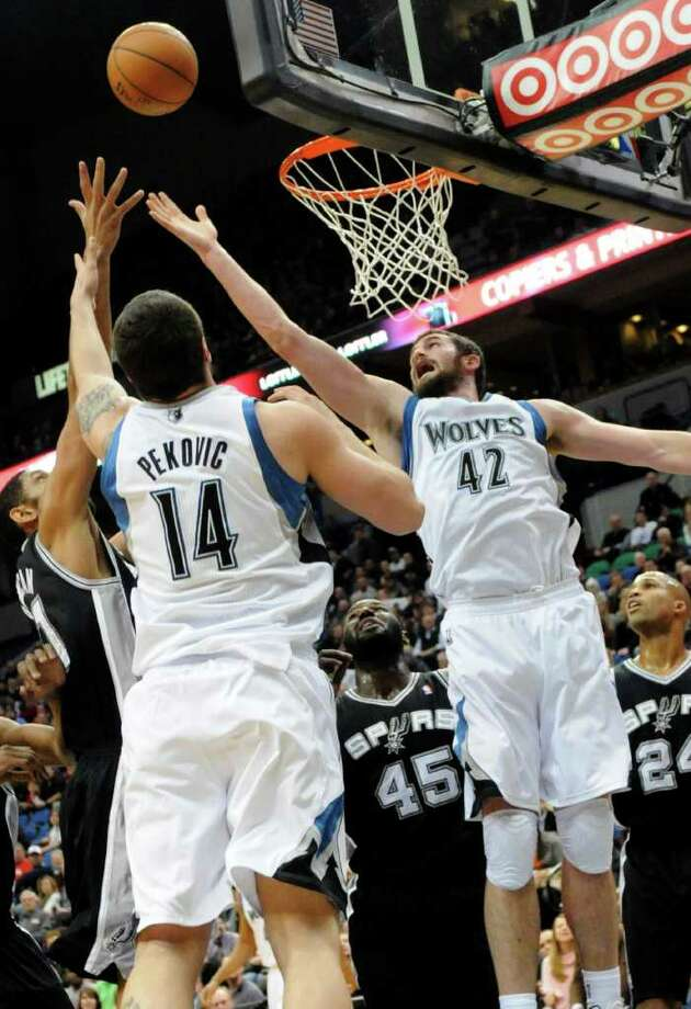 Minnesota Timberwolves' Kevin Love (42) and Nikola Pekovic (14) battle for a rebound with San Antonio Spurs' Tim Duncan, left, Dejuan Blair (45) and Richard Jefferson (24) during the first half of an NBA basketball game, Friday, Jan. 27, 2012, in Minneapolis. (AP Photo/Jim Mone) Photo: Associated Press