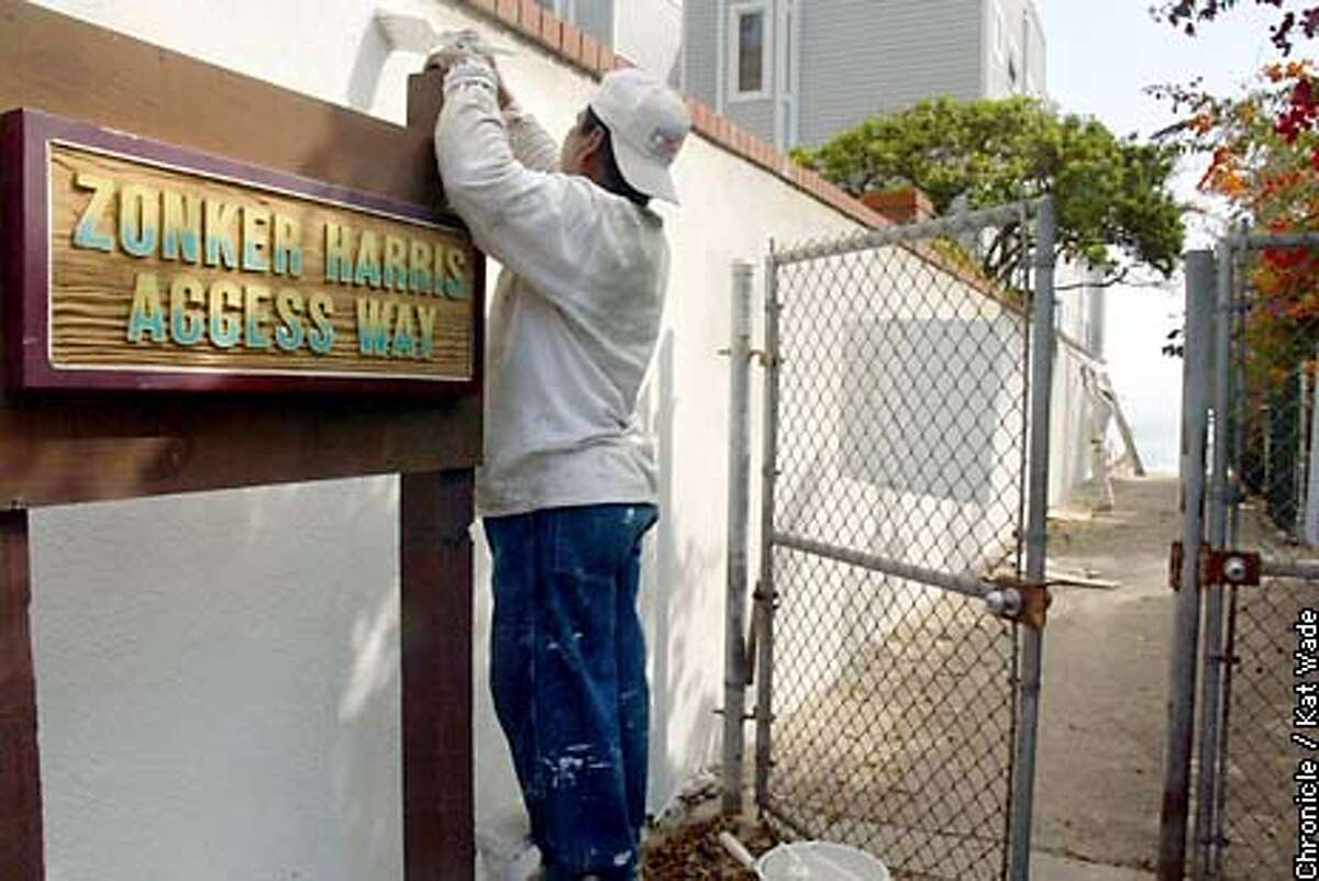 COASTALd-C-24SEP02-MN-KW - (L to R) Carlos Minero and Jason King of Lee's Painting put a fresh coat on the only public access to the Malibu Beach in five miles. SAN FRANCISCO CHRONICLE PHOTO BY KAT WADE