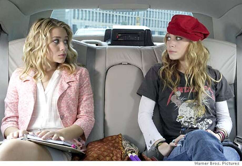 "Ashley Olsen and Mary-Kate Olsen star in Warner Bros. Pictures' action comedy ""New York Minute."" (AP Photo/ Warner Bros. Pictures)"