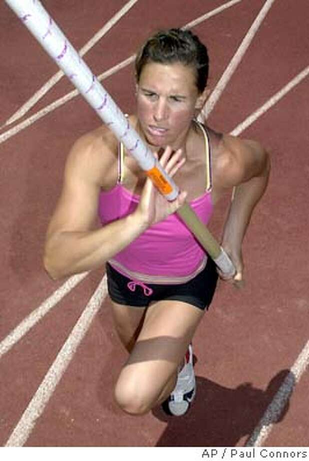 Women pole vaulting's only Olympic gold medal winner Stacey Dragila practices her approach during a workout session Friday, April 30, 2004, in Paradise Vallay, Ariz. Dragila, 33, has changed her technique in hopes of staying on top of one of track and fields most popular events.(AP Photo/Paul Connors) Photo: PAUL CONNORS
