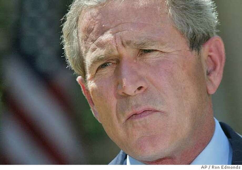 "President Bush apologized Thursday, May 6, 2004, for the abuse and humiliation of Iraqi prisoners by U.S. soldiers, saying the scenes of mistreatment had made Americans ""sick to our stomachs."" Bush made the comments during news conference with King Abdullah II at the White House. (AP Photo/Ron Edmonds) Photo: RON EDMONDS"