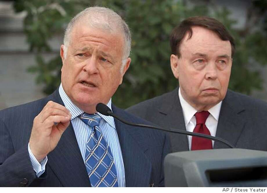 "** FILE ** Sen. Don Perata, D-Oakland, left, and Sen. Ross Johnson, R-Irvine, talk about problems encountered during a primary election earlier in the year with touch-screen voting systems, during a news conference in Sacramento, Calif., March 11, 2004. A proposal to ban all electronic voting machines in the November election was approved by a Senate committee Wednesday, May 5, less than a week after Secretary of State Kevin Shelley's decision to decertify the machines unless they meet certain conditions. ""The key to democracy is that everyone's vote counts and is counted. The electronic voting machines used in the March primary failed to meet that fundamental test,"" said Johnson, one of the bill's authors. (AP Photo/Steve Yeater) MARCH 11, 2004, PHOTO Photo: STEVE YEATER"
