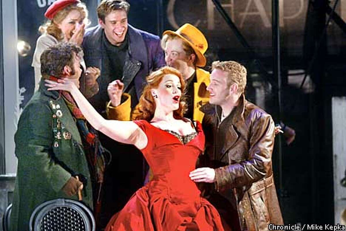 The red cast of Baz Luhrmann's La Boheme during the MOMUS scene. BY MIKE KEPKA/THE CHRONICLE