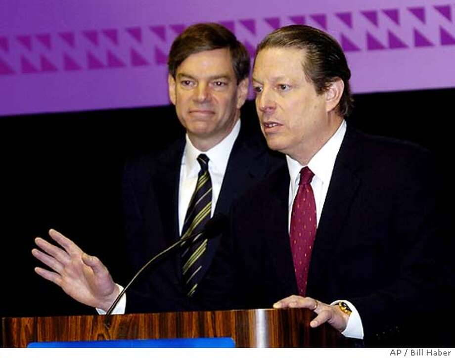 """Former Vice President Al Gore and business partner Joel Hyatt, left, answer questions at a news conference New Orleans Tuesday, May 5, 2004. Gore announced he and a group of investors were launching an independent cable televison network. Gore said the network will be """"an independent voice in this industry"""" with a primary target audience of people between 18 and 34 """"who want to learn about the world in a voice they recognize and a view they recognize as their own."""" (AP Photo/Bill Haber) Photo: BILL HABER"""