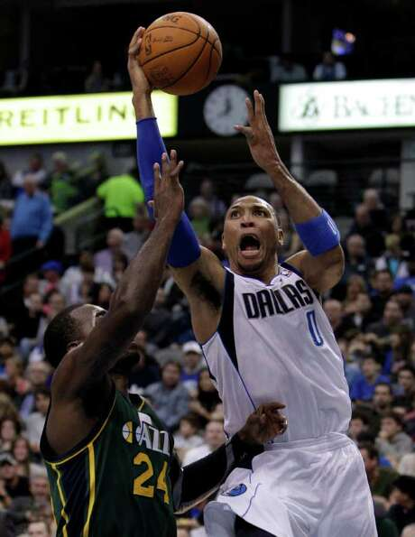 Dallas Mavericks' Shawn Marion (0) goes up for a shot over Utah Jazz's Paul Millsap (24) in the first half of an NBA basketball game on Friday, Jan. 27, 2012, in Dallas. Photo: AP