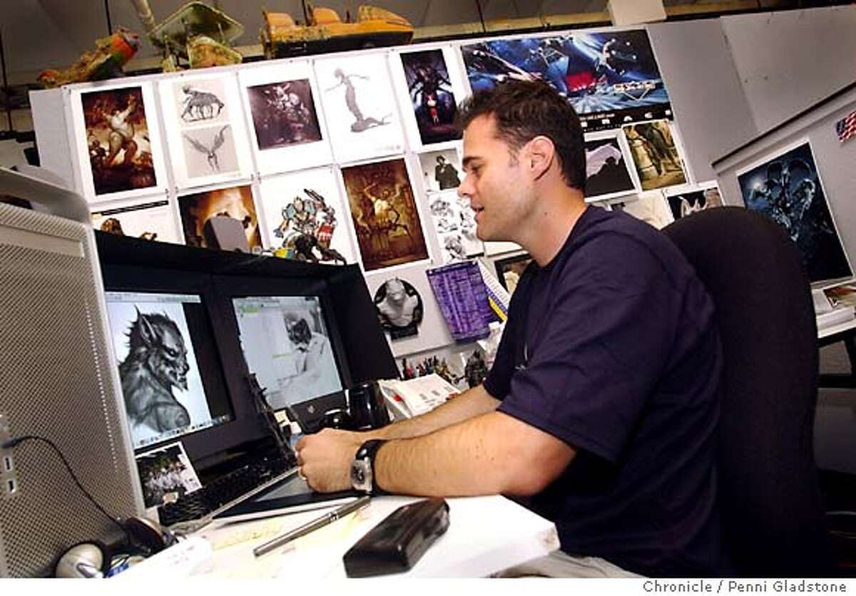 Christian Alzmann works at his desk surrounded by toys and drawings. VAN HELSING, first big special effects movie of the summer. Visual effects art dir. photo taken on 4/28/04 in San Rafael, CA. photo by Penni Gladstone/The San Francisco Chronicle