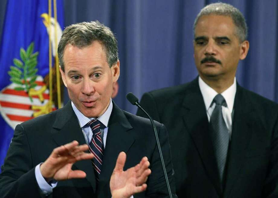 WASHINGTON, DC - JANUARY 27: New York Attorney General Eric Schneiderman (L) speaks whille Attorney General Eric Holder listens during a news conference at the Justice Department on January 27, 2012 in Washington, DC. Attorney General Holder announced the formation of the residential mortgage backed securities group that will investigate fraud in residential mortgage backed securities.   (Photo by Mark Wilson/Getty Images) Photo: Mark Wilson