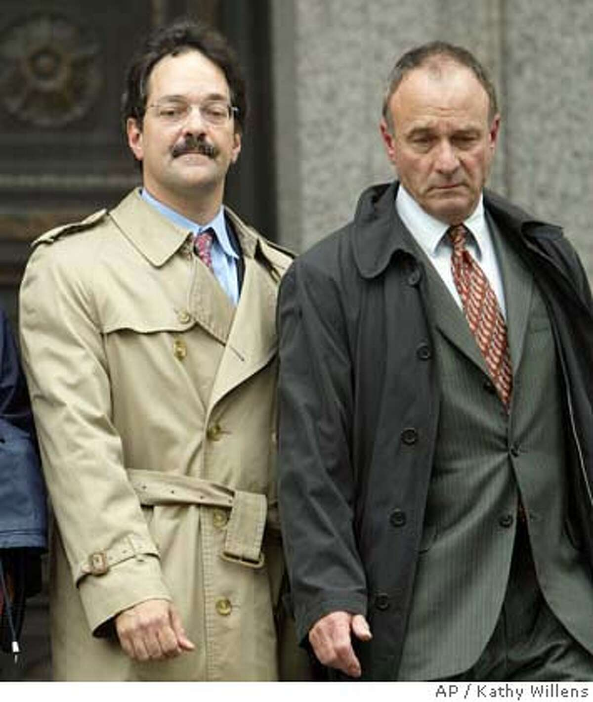 Former star investment banker Frank Quattrone, left, and his attorney John Keker leave Manhattan Federal Court, Monday, May 3, 2004, in New York, after Quattrone was found guilty on all counts in his retrial for obstructing a grand jury, obstructing federal regulators and witness tampering. (AP Photo/Kathy Willens)