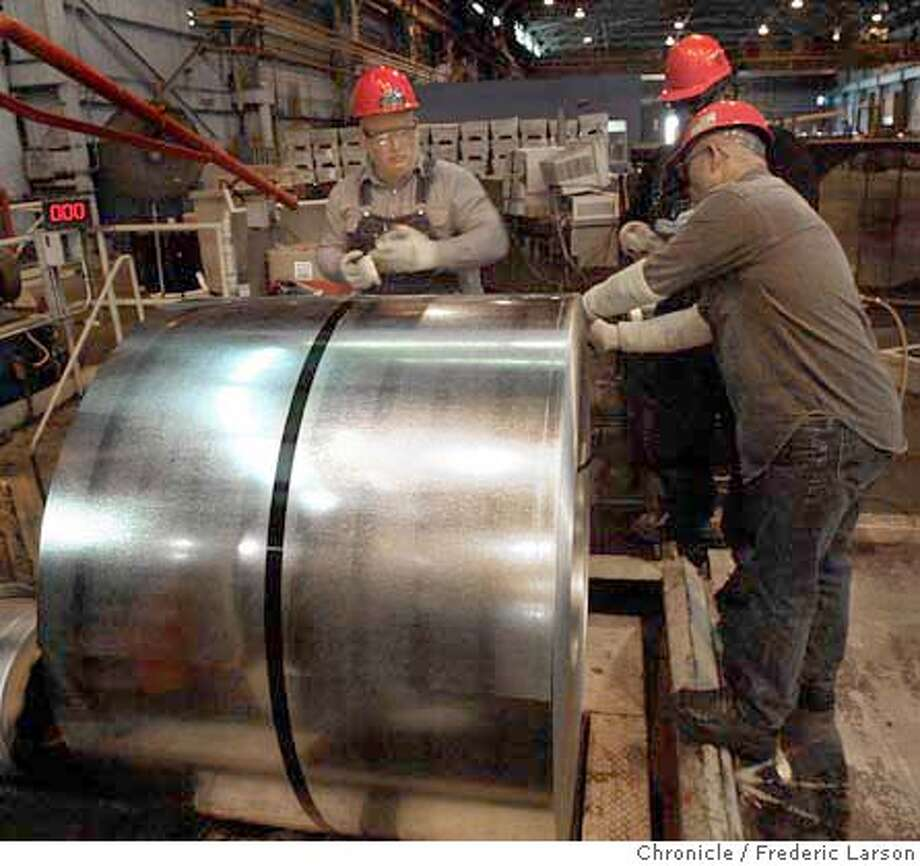 ; John Moglie (left) Scipio Spears and Jerry Sander work on transporting the final coil of steel for shipping. Steel production processes at USS-Posco, a good-sized, ultra-modern steel plant in Pittsburg,  City:� Day}/ The Chronicle; Photo: Frederic Larson