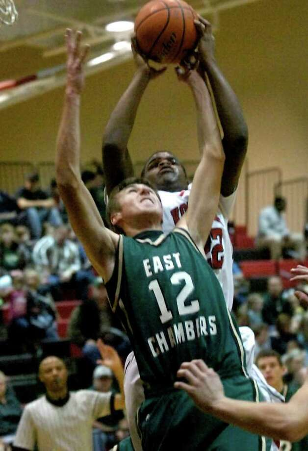 East Chambers' Robin Pechel and Kountze's Corey Lowe battle for the rebound at Kountze High School in Kountze, Friday, January 27, 2012. Tammy McKinley/The Enterprise Photo: TAMMY MCKINLEY