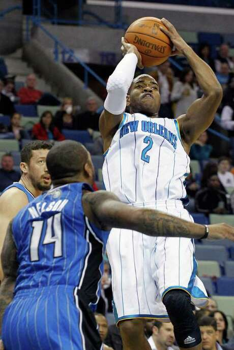 New Orleans Hornets point guard Jarrett Jack (2) shoots over Orlando Magic point guard Jameer Nelson (14) in the first half of an NBA basketball game in New Orleans, Friday, Jan. 27, 2012. Photo: AP