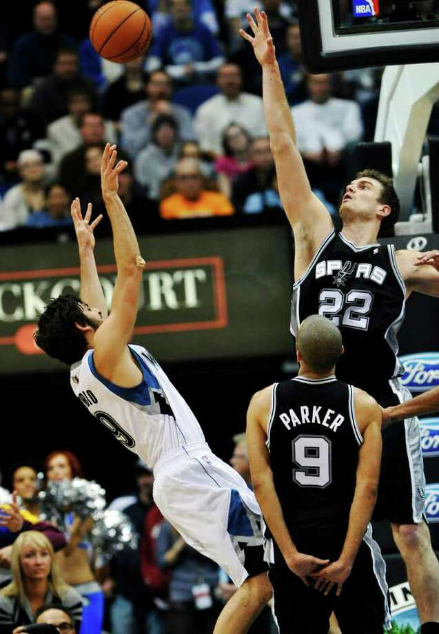 San Antonio Spurs' Tiago Splitter (22), of Brazil, and Tony Parker (9), of France, defend against a shot by Minnesota Timberwolves' Ricky Rubio, of Spain, in the second half of an NBA basketball game, Friday, Jan. 27, 2012, in Minneapolis. The Timberwolves won 87-79. (AP Photo/Jim Mone) Photo: Associated Press