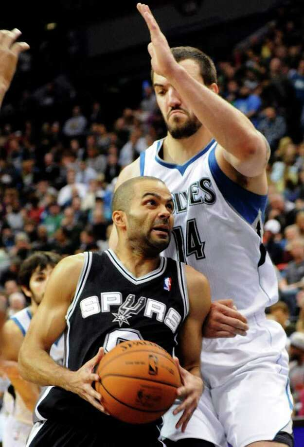 San Antonio Spurs' Tony Parker, of France, left, drives past Minnesota Timberwolves' Nikola Pekovic, of Montenegro, during the second half of an NBA basketball game, Friday, Jan. 27, 2012, in Minneapolis. The Timberwolves won 87-79. (AP Photo/Jim Mone) Photo: Associated Press