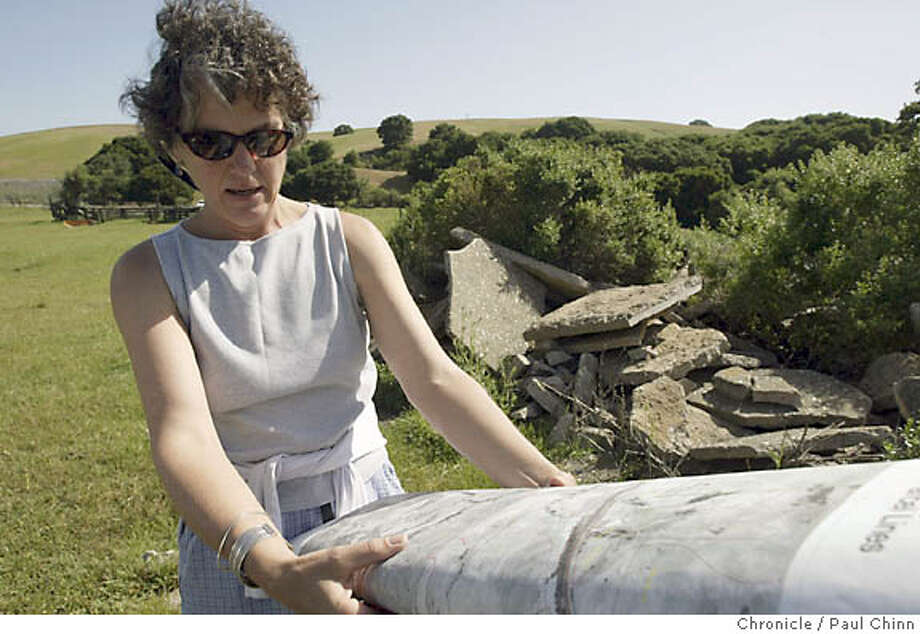 Tina Batt, executive director of the Muir Heritage Land Trust, unrolls a topographic map of the site. The land trust is acquiring the 700-acre site from the Fernandez family. Fernandez Ranch property on 4/30/04 in Hercules. PAUL CHINN/The Chronicle Photo: PAUL CHINN
