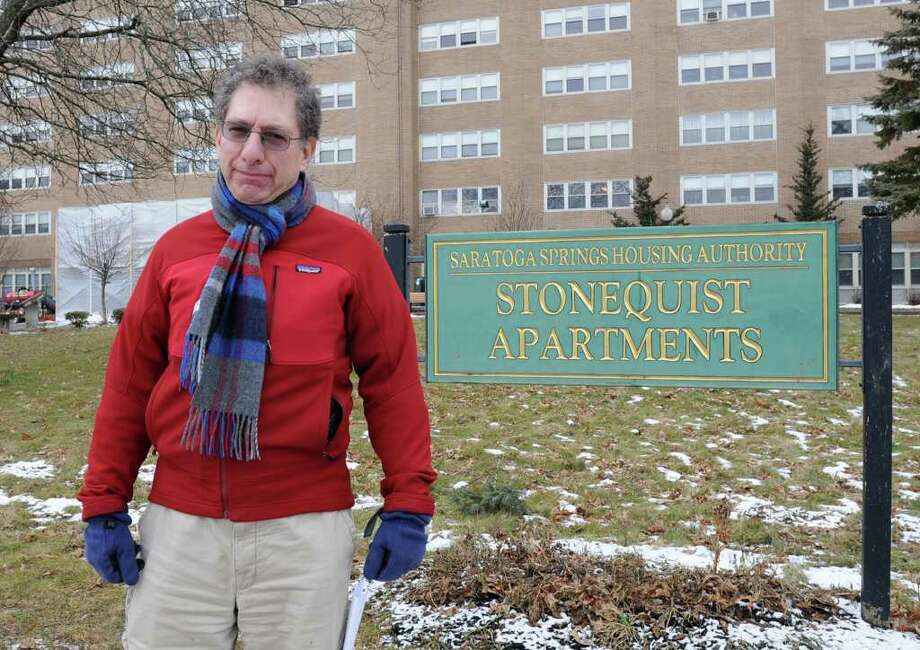 John Kaufmann stands in front of Stonequist Apartments where the office for the Saratoga Housing Authority is Thursday Jan 26, 2012 in Saratoga Springs, N.Y. Kaufmann is the lead critic in what's been happening at the Housing Authority. (Lori Van Buren / Times Union) Photo: Lori Van Buren