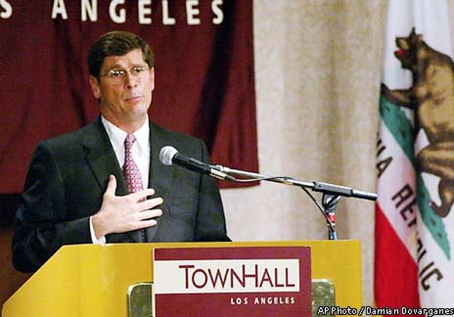 "Republican gubernatorial candidate Bill Simon expressed his ""sincere regret"" on Thursday, Oct. 10, 2002, over his now-disproven allegation that Democratic incumbent Gray Davis illegally accepted a campaign check in the state Capitol, in a noon speech at Town Hall Los Angeles. (AP Photo/Damian Dovarganes) Photo: DAMIAN DOVARGANES"