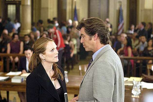 "Julianne Moore (left) stars as Audrey and Pierce Brosnan (right) stars as Daniel in New Line Cinemas romantic comedy, ""Laws of Attraction. (AP Photo/Barry Wetcher) Photo: BERNARD WALSH"