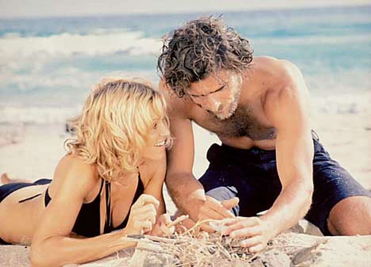 """High and dry Madonna and Adriano Giannini in """"Swept Away,"""" based on Lina Wertmuller's 1974 film and directed by Madonna's husband, Guy Ritchie. Photo by Daniel Smith"""