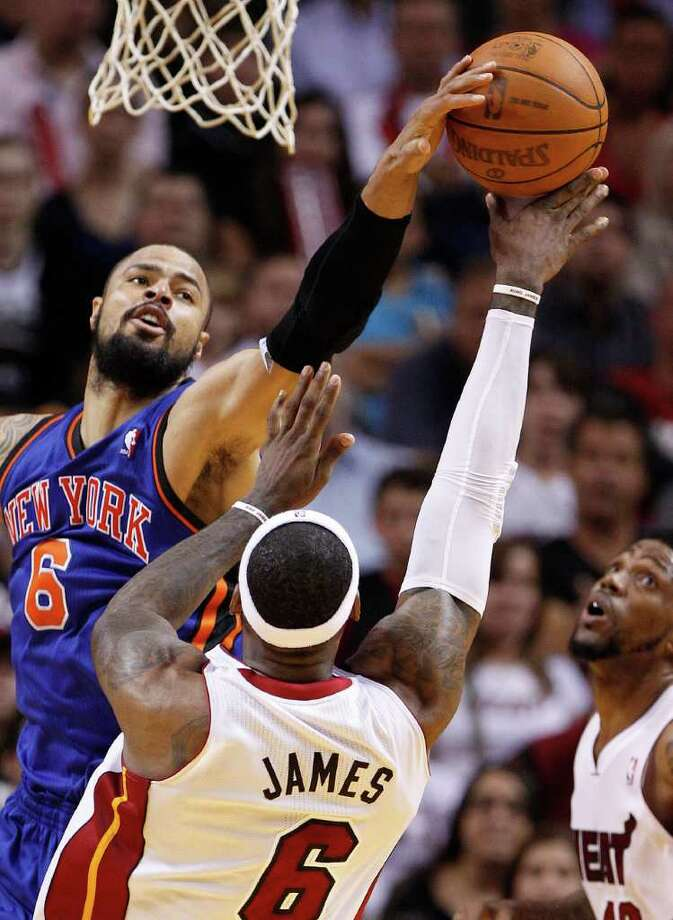 Miami Heat's LeBron James, front, shoots against New York Knicks' Tyson Chandler during the second half of an NBA basketball game, Friday, Jan. 27, 2012, in Miami. The Heat defeated the Knicks 99-89. (AP Photo/Lynne Sladky) Photo: Lynne Sladky