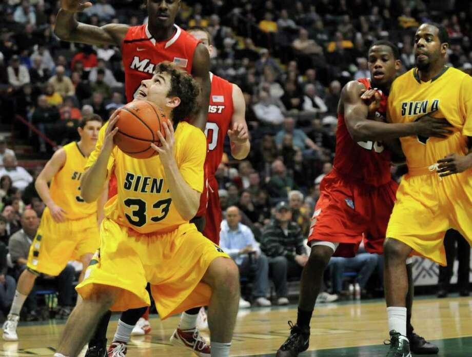 Siena's Rob Poole (33), left, looks to the hoop during their basketball game against Marist on Friday, Jan. 27, 2012, at Times Union Center in Albany, N.Y. Siena wins 66-55. (Cindy Schultz / Times Union) Photo: Cindy Schultz / 00015373J
