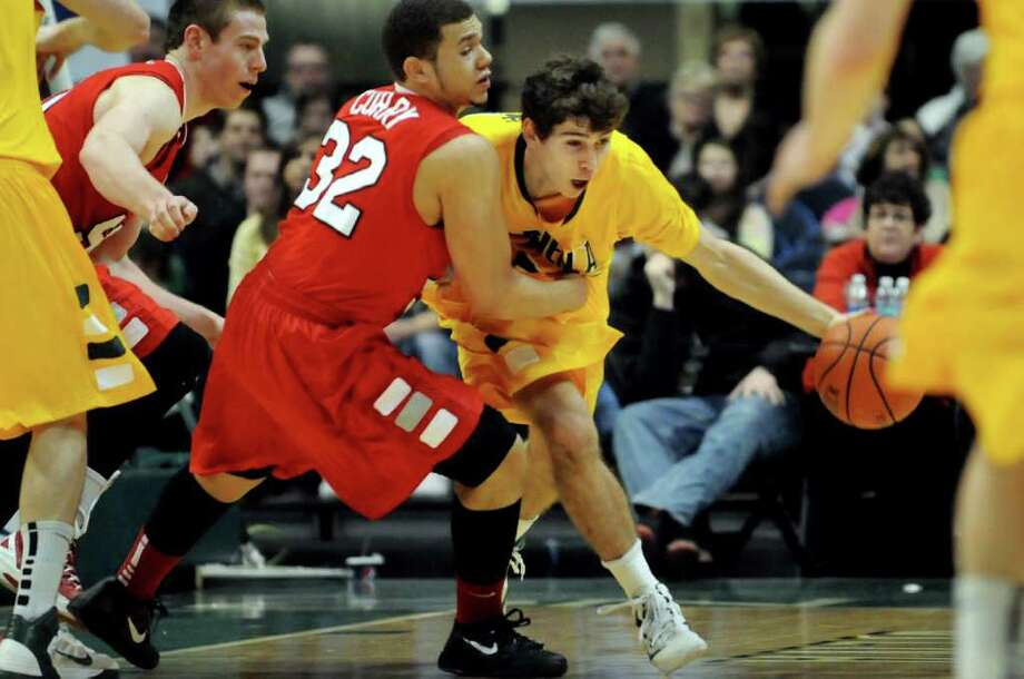 Siena's Rob Poole (33), right, grabs the rebound and runs as Marist's T.J. Curry (32) defends during their basketball game against Marist on Friday, Jan. 27, 2012, at Times Union Center in Albany, N.Y. (Cindy Schultz / Times Union) Photo: Cindy Schultz / 00015373J