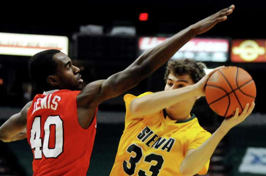 Siena's Rob Poole (33), right, protects the ball as Marist's Chavaughn Lewis (40) defends during the
