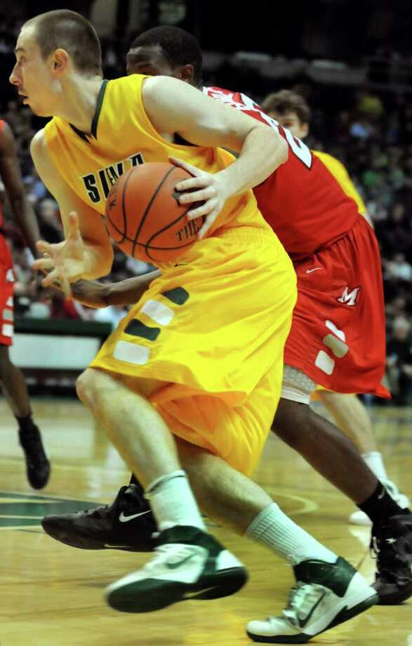 Siena's Owen Wignot (31) drives for the hoop during their basketball game against Marist on Friday, Jan. 27, 2012, at Times Union Center in Albany, N.Y. (Cindy Schultz / Times Union) Photo: Cindy Schultz / 00015373J