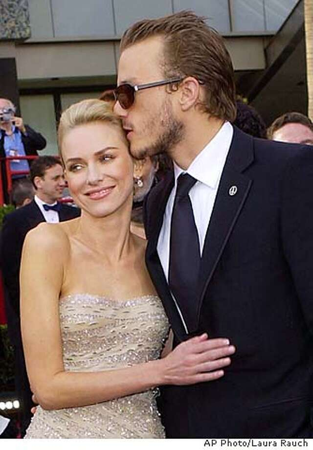 "Heath Ledger kisses Naomi Watts as they arrive at the 76th annual Academy Awards in Los Angeles, Calif. Sunday, Feb. 29. 2004. Watts is nominated for best actress in a leading role for her work in ""21 Grams."" (AP Photo/Laura Rauch) Photo: Laura Rauch"