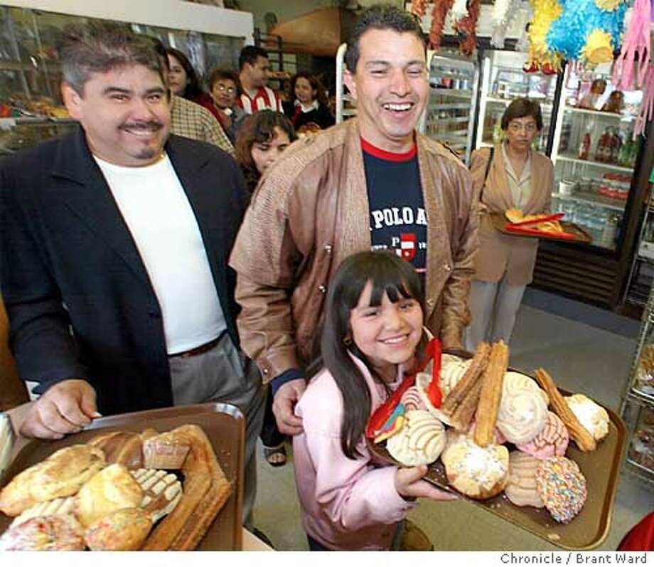 panaderia029_bw.jpg Jennifer Perez and her father Jaime, center, get the giggles as they wait in line with their bakery goods at Dominguez bakery.  Dominguez bakery on 24th Street in the Mission district has been open for about 30 years on Sundays only...they become especially busy right after St. Peters Catholic Church finishes mass right across the street. BRANT WARD / The Chronicle Photo: BRANT WARD