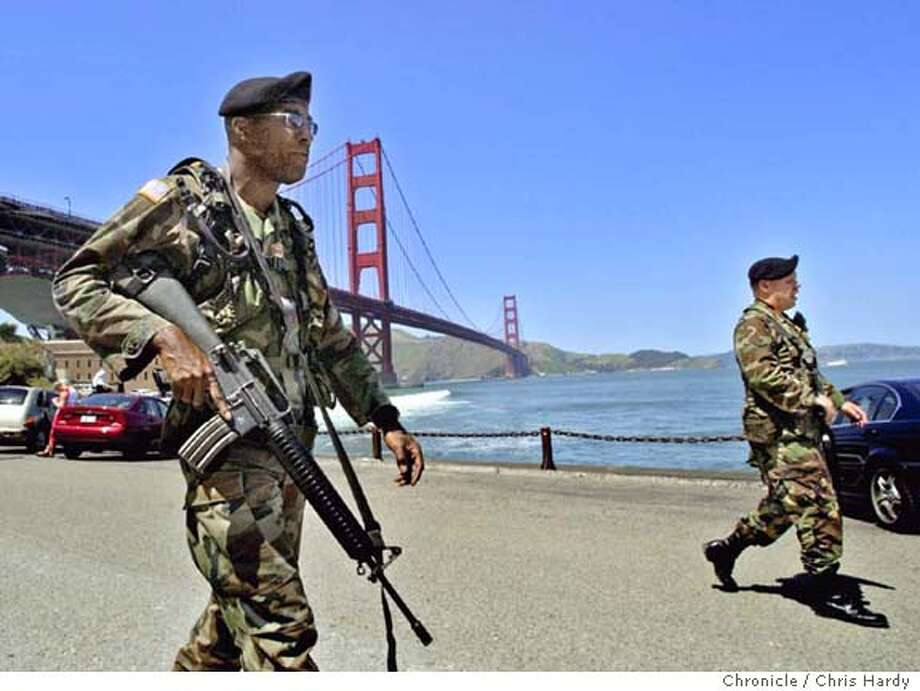 The California National Guard, which has been guarding the famous span since the 9/11 attacks, is pulling out Friday. Here we have sgts Randy Walton(white guy) and Daryl Crier patrol Fort Point.  at San Francisco,CA  San Francisco Chronicle/Chris Hardy Photo: Chris Hardy