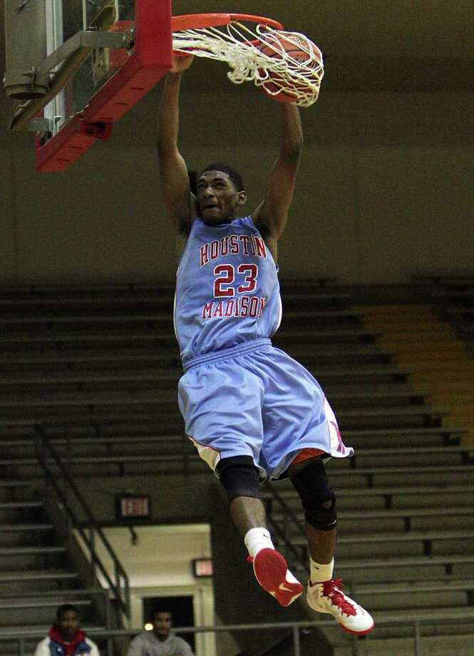 Madison's Darius Hargrove soars in for an uncontested dunk against Westside on Friday. Photo: Bob Levey / ©2012 Bob Levey
