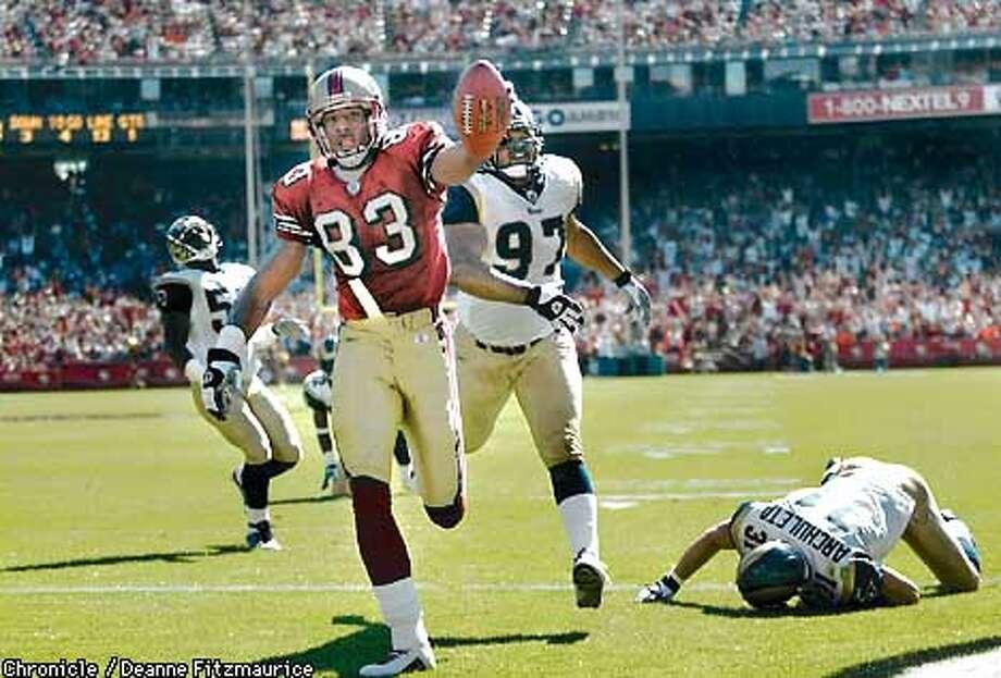 4aadc675703 J.J. Stokes scores a touchdown in the 1st quarter. San Francisco 49ers vs  St Louis