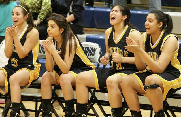 Members of the Lady Brennan Bears basketball team react near the end of the game with Boerne Champion Friday Jan. 27, 2012 at Boerne Champion High School in Boerne, Tx. Brennan won in overtime 62-55. Photo: EDWARD A. ORNELAS, Express-News / © San Antonio Express-News (NFS)