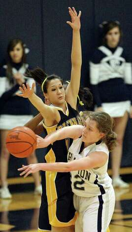 Boerne Champion's Mallory Williams  passes around Brennan's Kealani Marquez during first half action Friday Jan. 27, 2012 at Boerne Champion High School in Boerne, Tx. Brennan won in overtime 62-55. Photo: EDWARD A. ORNELAS, Express-News / © San Antonio Express-News (NFS)