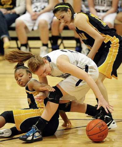 Brennan's  Ashlynn Graham  and Brennan's Kealani Marquez grab for a loos ball against  Boerne Champion's Heather Hormuth during second half action Friday Jan. 27, 2012 at Boerne Champion High School in Boerne, Tx. Brennan won in overtime 62-55. Photo: EDWARD A. ORNELAS, Express-News / © San Antonio Express-News (NFS)