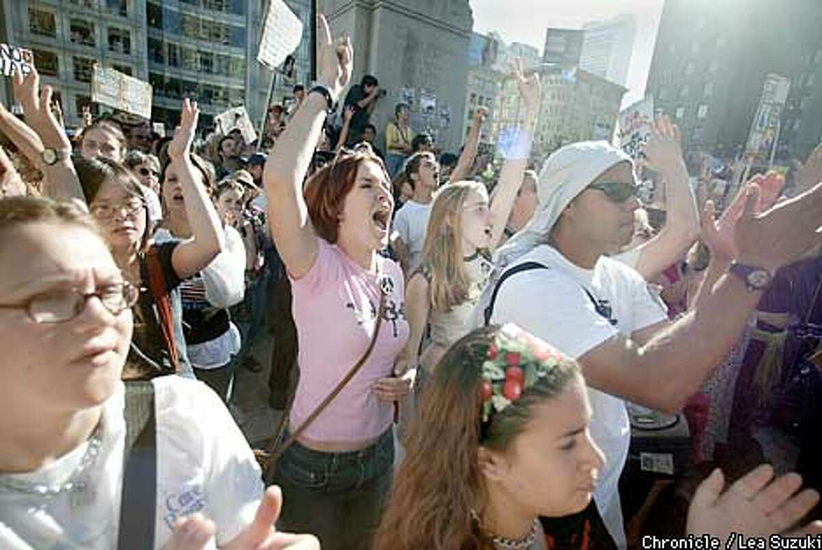 CENTER IN PINK SHIRT FROM LEFT: Margaret McCarthy and Katrina Yeaw, SFSU students cheer speakers at a Rally in Union Square on Sunday afternoon. AFTERNOON. PHOTO BY LEA SUZUKI