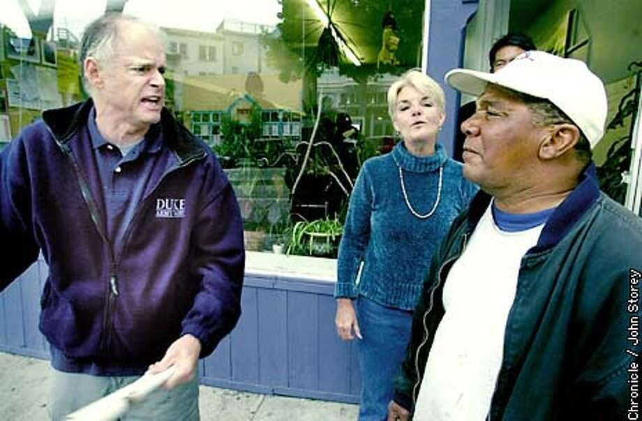 HOMELESS-C-27SEP02-MT-JRS-Story about the North Beach Homeless Project. Landlord Richard Hanlin (far left) argues with homeless man Joe Vaughn in fron the homeless project as Executive director Charee Lord looks on. Chronicle photo by John Storey. Photo: John Storey