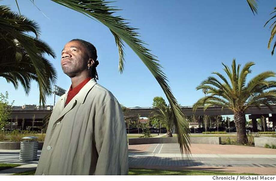 "Hood stands amoung the many palm trees that fill his design of the ""Splashpad Park"" at the corner of Grand Ave. and Lake Park St. in Oakland. Walter Hood an esteemed African American landscape architect is being honored by the city of Oakland on Saturday as part of Earth Day. event on 4/23/04 in San Francisco Michael Macor / San Francisco Chronicle Photo: Michael Macor"