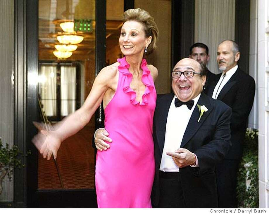 Actor Danny DeVito greets with Roxanne Messina Captor, executive director of San Francisco Film Society, at the San Francisco International Film Festival awards night at Ritz Carlton hotel.  Event on 4/22/04 in San Francisco.  Darryl Bush / The Chronicle Photo: Darryl Bush