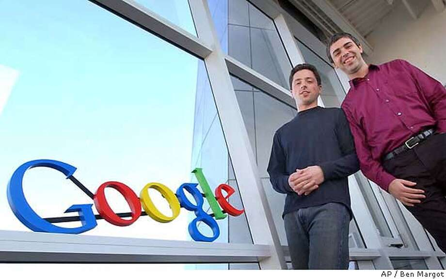 Google co-founders Sergey Brin, left, and Larry Page are seen at company headquarters Thursday, Jan. 15, 2004, in Mountain View, Calif. The online search engine unveiled a significant index of its Web index Tuesday, Feb. 17, 2004, as it gears up for tougher competition from Yahoo and Microsoft. Google's index now covers 4.3 billion Web pages, up from 3.3 billion and the company says it is drilling much deeper into Web sites to provide much greater breadth. Google also acknowledged it has made significant changes to its closely guarded formula for sorting through its results during the past two ranks, a shift that has dismayed some Webmasters. (AP Photo/Ben Margot) Paul Moller intends to conduct test flights in his flying car over land he owns in Dixon. Business#Business#Chronicle##ALL#Advance##0421624965 Photo: BEN MARGOT