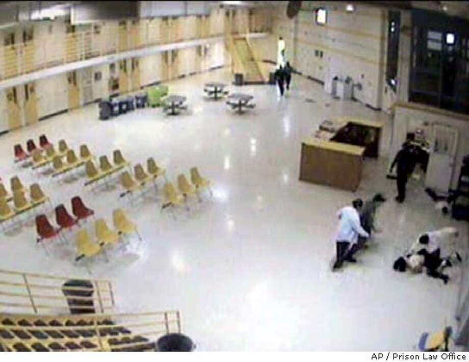 One of two wards of the California is seen being beaten by a corrections employee at right in this image from a surveillance camera taken at the N.A. Chaderjian Youth Correctional Facility in Stockton, Calif., Jan. 20, 2004. The video tape was shown to reporters at the Capitol by State Sen. Gloria Romero, D-Los Angeles, and Don Spector, director of the Prison Law Office Thursday, April 1, 2004. Romero and Spector are urging prosecution of the employees. The second wardcan be seen lying on the floor above the fight.(AP Photo/Courtesy of Prison Law Office)